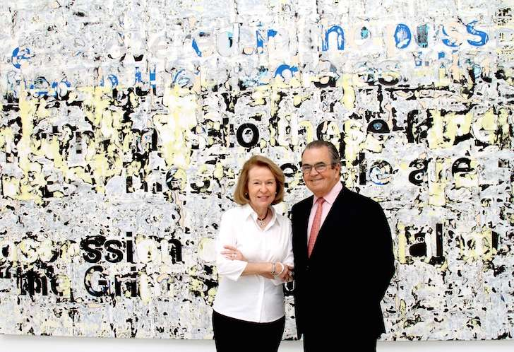"Carlos + Rosa de la Cruz in front of ""Untitled,"" 2011 by Mark Bradford"