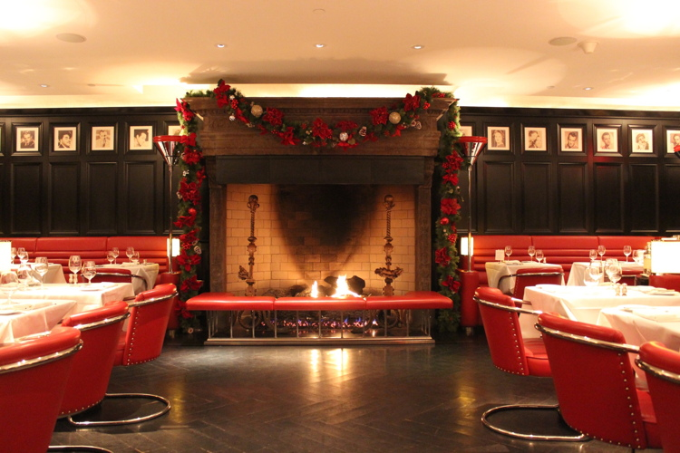 REThe Lambs Club Dining Room and Fireplace with Holiday Decor