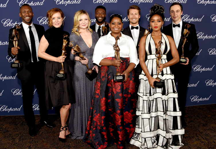 Mahershala Ali, Kimberly Quinn, Kirsten Dunst, Aldis Hodge, Octavia Spencer, Glen Powell, Janelle Monae and Jim Parsons pose with the Ensemble Performance Award during the 28th Annual Palm Springs International Film Festival Film Awards Gala