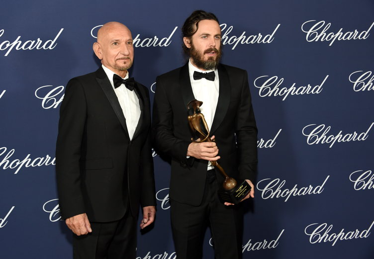 Casey Affleck poses with the Desert Palm Achievement Award and actor Ben Kingsley during the 28th Annual Palm Springs International Film Festival Film Awards Gala