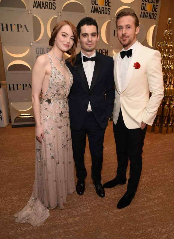 (L-R) Actress Emma Stone, director Damien Chazelle, actor Ryan Gosling attend the 74th Annual Golden Globe Awards