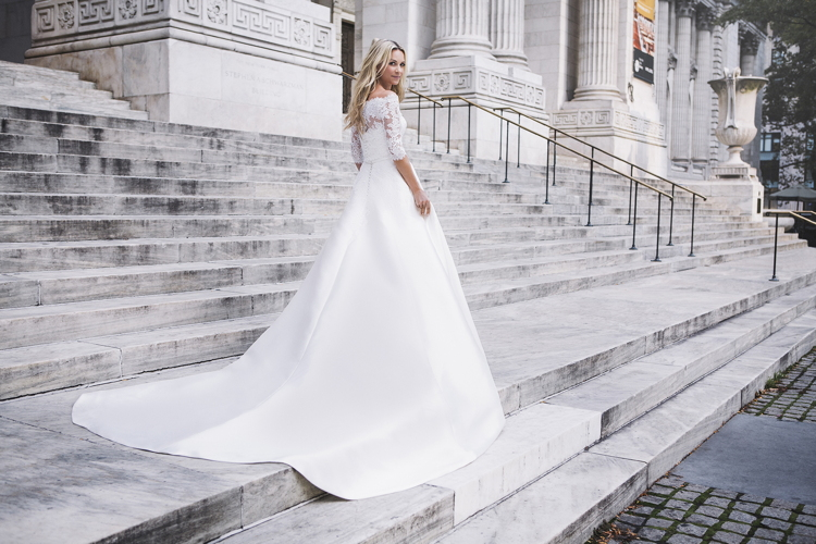 Blair Eadie models a bridal gown from Pronovias Atelier 2017 collection at the New York Public Library.