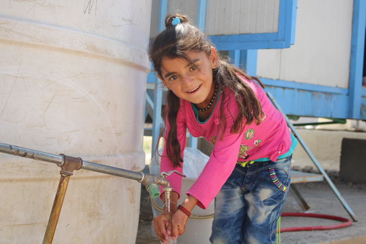 "In May 2016, Hayman, an 8-year old, says, ""Water for drinking and washing is always available in the school."" in Nowruz camp in the Syruian Arab Republic. Some 5,000 refugees from Iraq live in the Nowruz camp. UNICEF has installed 64 prefabricated latrine unites and 50 water tanks for safe access to water and sanitation."