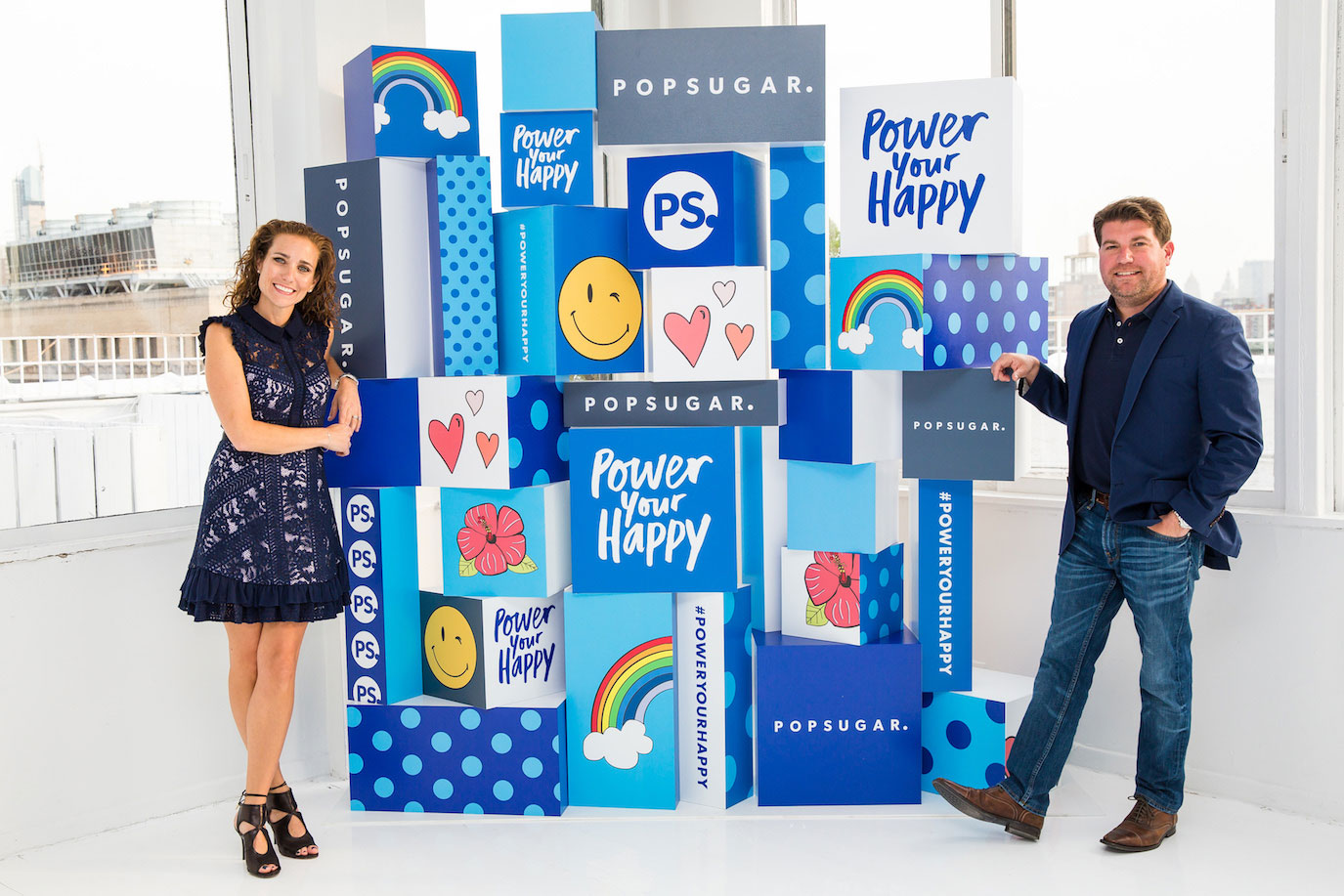 Lisa and her husband, Brian, smile at an event launching Lisa's first book, Power Your Happy.