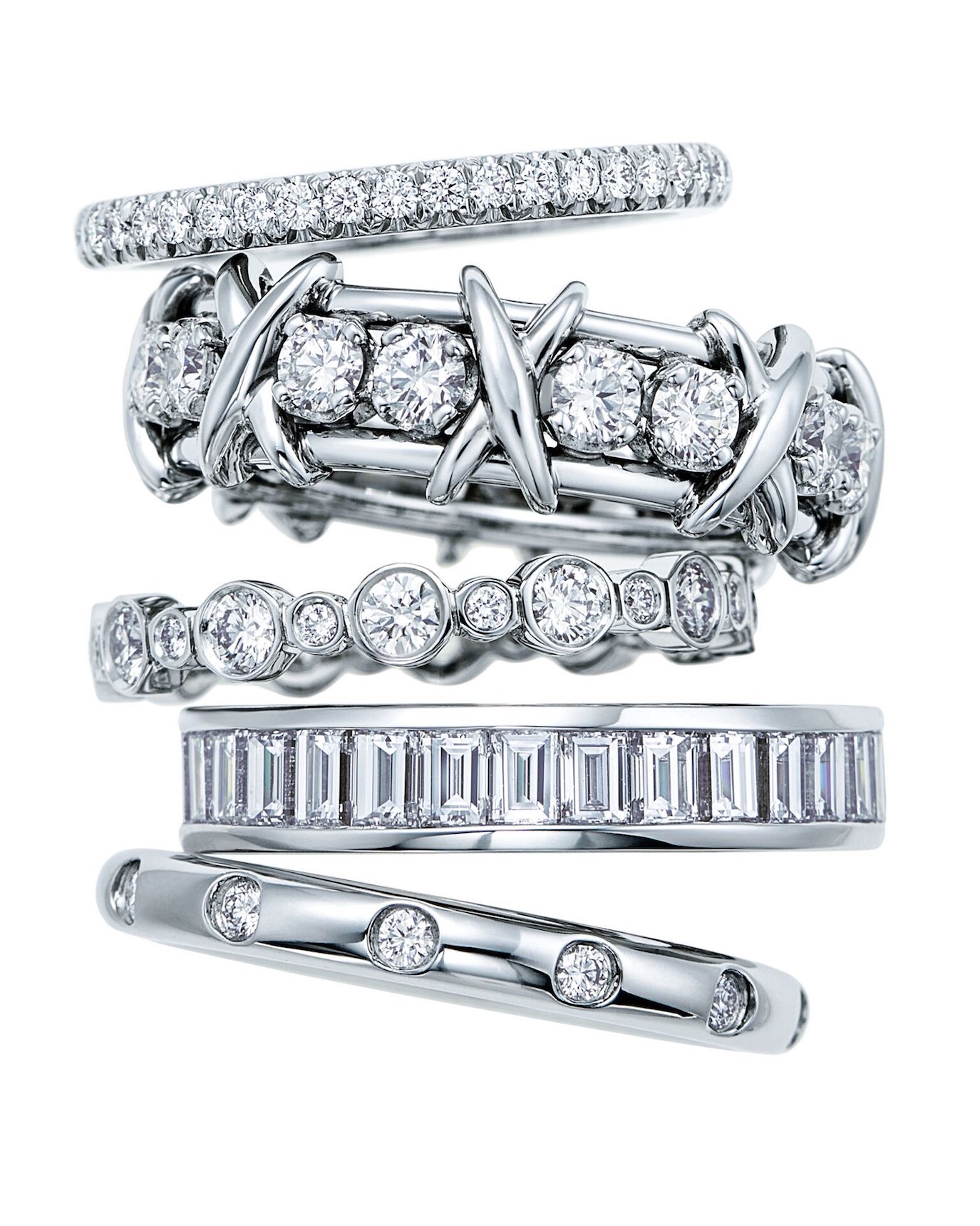 Top to bottom: Bands in platinum with diamonds: Tiffany Soleste; Tiffany & Co. Schlumberger Sixteen Stone; Tiffany Jazz Channel set; and Tiffany Bezet