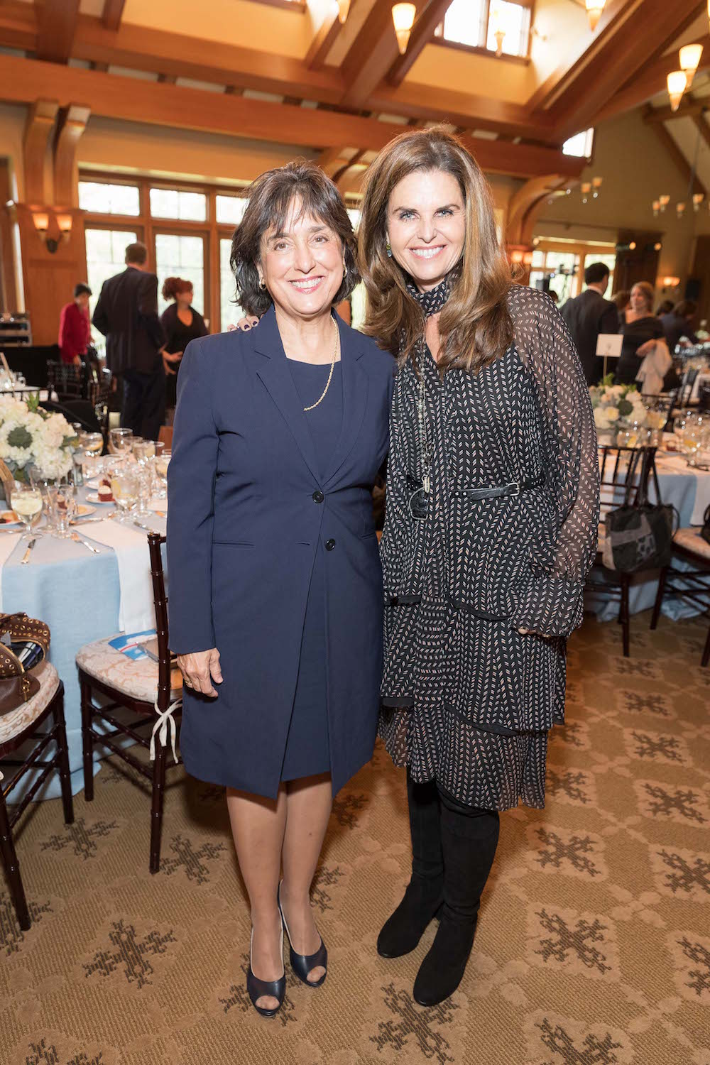 Roberta Diaz Brinton and Maria Shriver attend Part the Cloud Luncheon on February 1