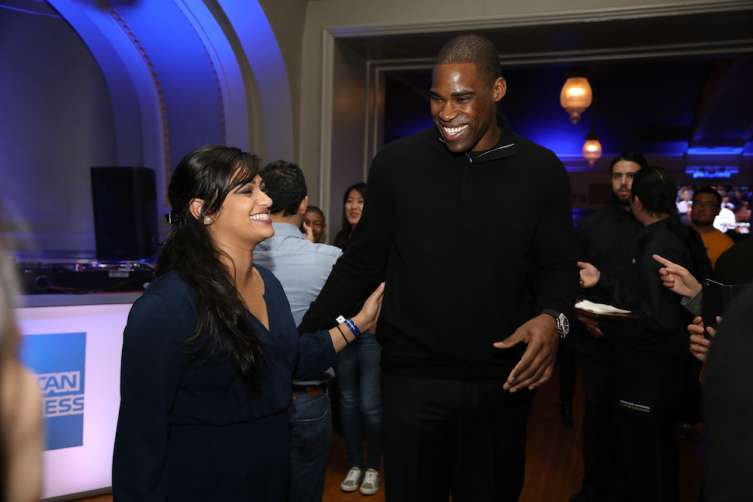 Golden State Warriors legend Antawn Jamison greets a fan