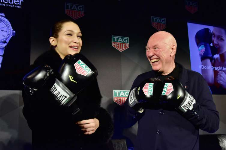 CEO of TAG Heuer Jean-Claude Biver (L) and Bella Hadid