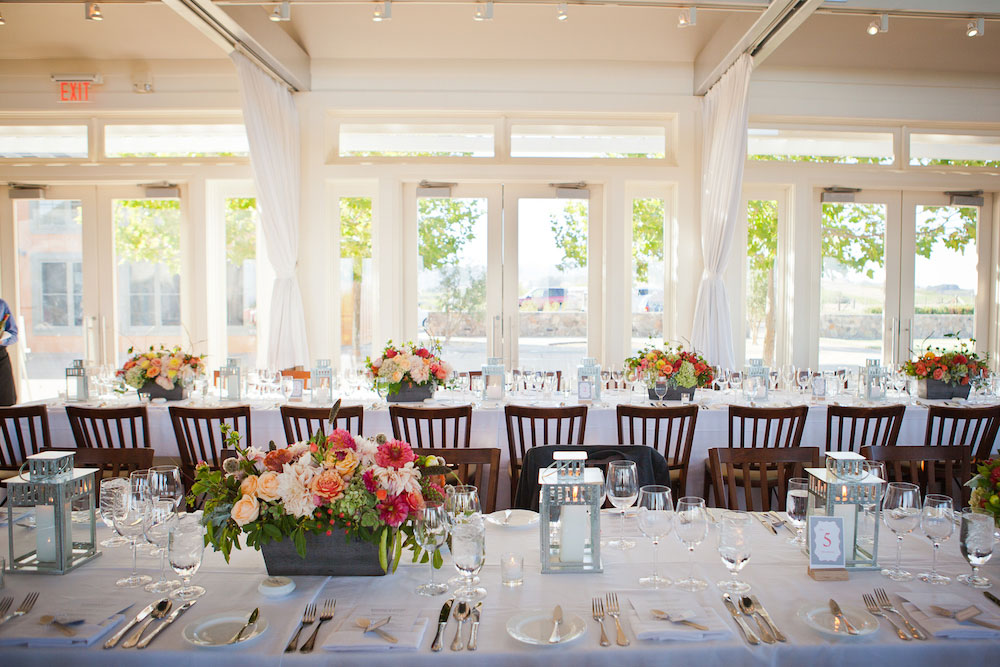 The tables set for the family style supper club event