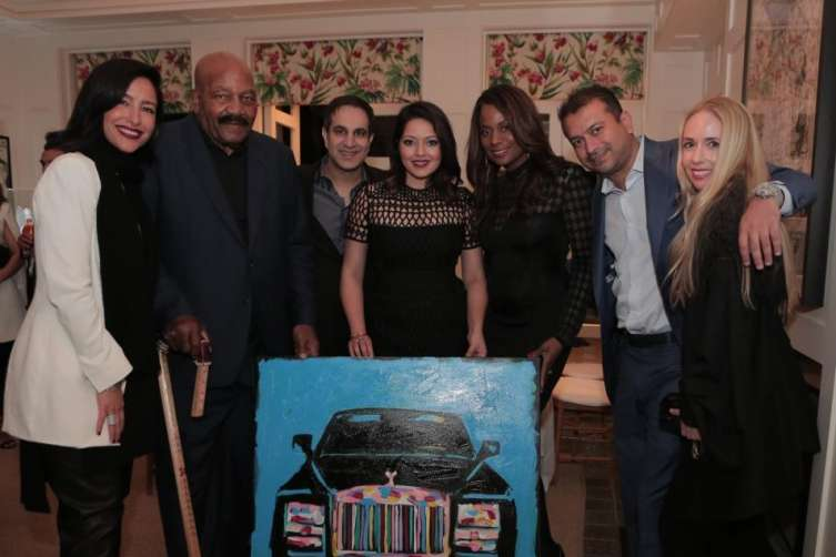 Rekha Muddaraj and Dr. Neil Badlani (middle) with their Bradley Theodore painting