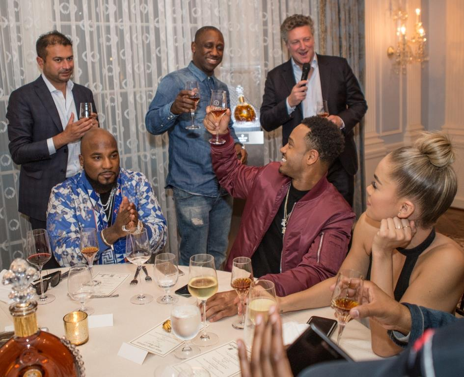 Joung Jeezy (sitted, left), Chaka Zulu (standing, middle), Terrence J. (sitted, middle) and Jasmine Sanders (sitted, right) raise a toast with Louis XIII cognac. | photos by Thaddaeus McAdams