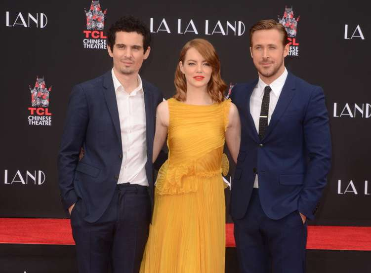 Damien Chazelle, Emma Stone and Ryan Gosling attend the La La Land hand and foot ceremony at the TCL Chinese Theater