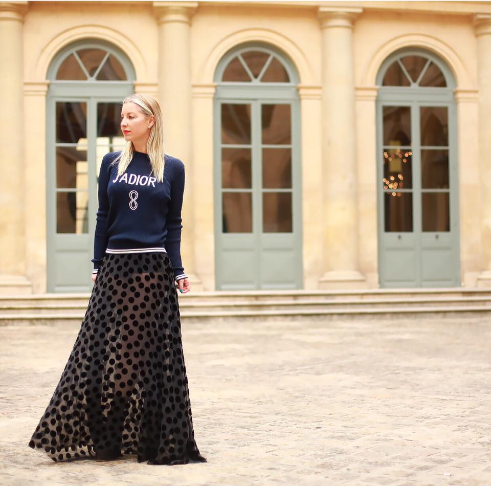 Sonya Molodetskaya in Paris wearing a Major Obsessions skirt and Dior sweatshirt.