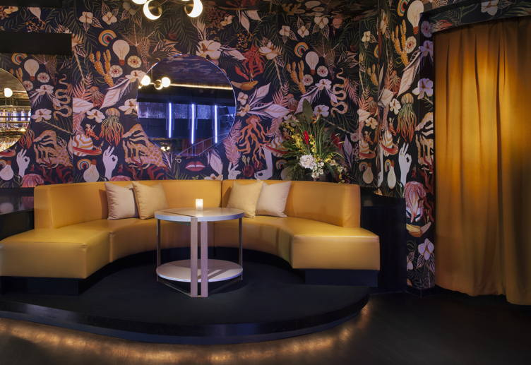 Chill out on this lush banquette at Nightingale Plaza
