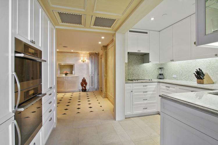 The kitchen has numerous high-end appliances.