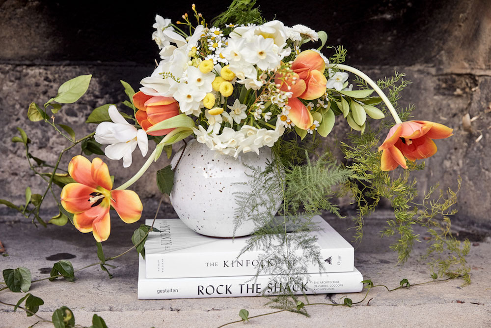 Vignettes from Kayne's life show some of her favorite things: beautiful flowers and interesting reads.