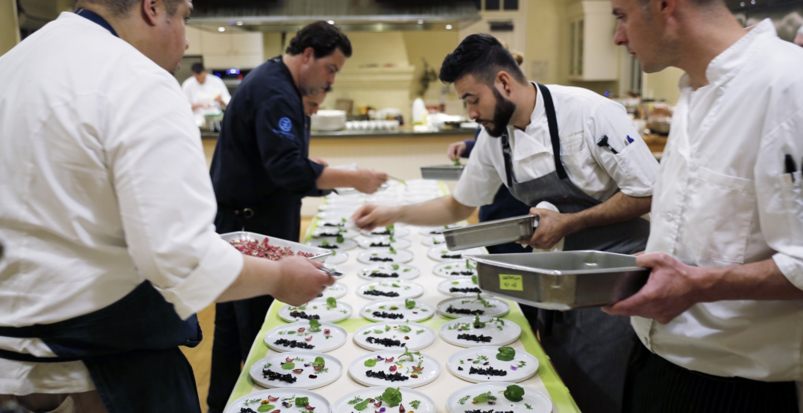 Chefs work the line at the 2016 Lexus Culinary Classic