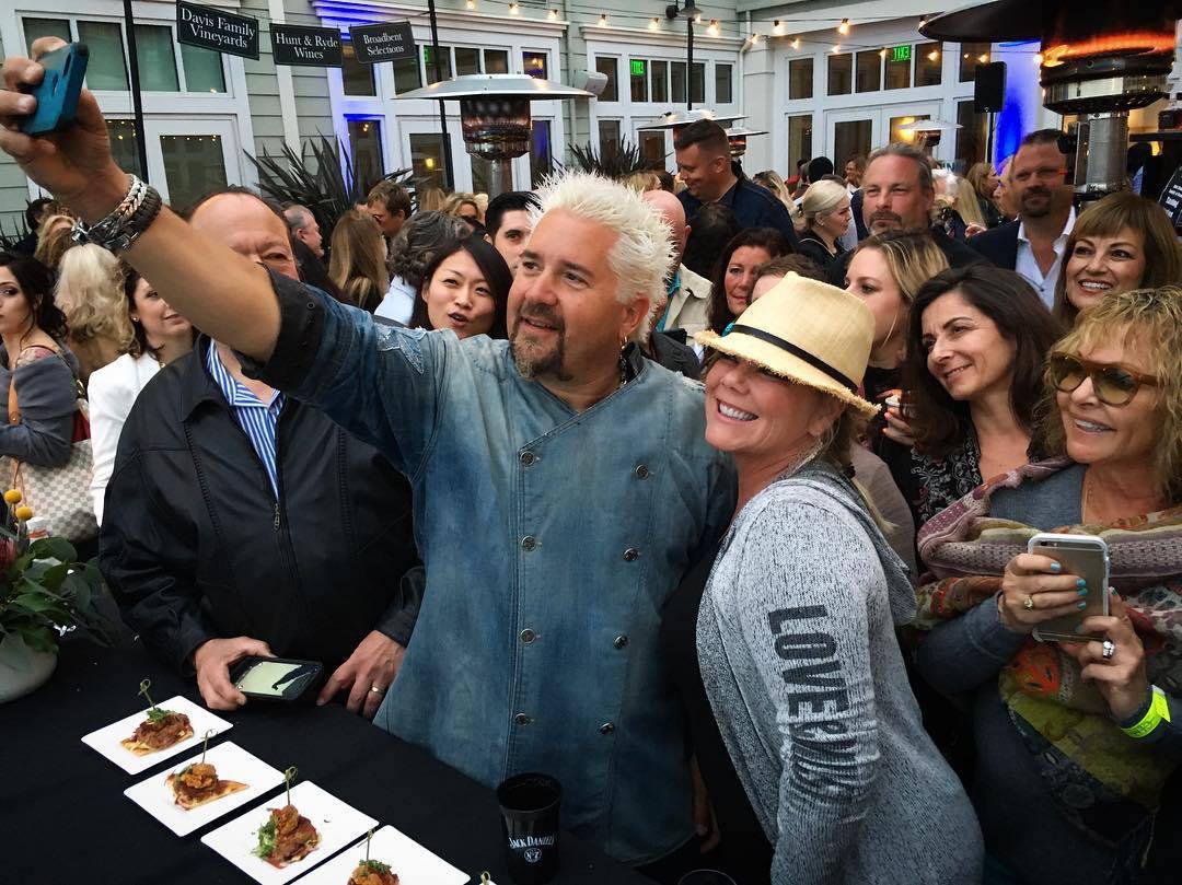 Guy Fieri poses with fans at last year's event