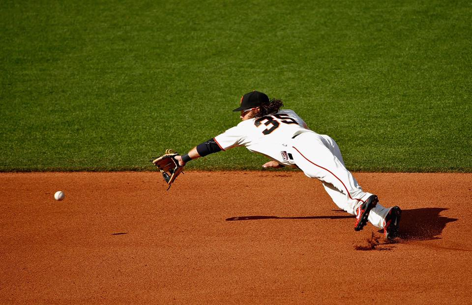 Crawford dives to catch a ball