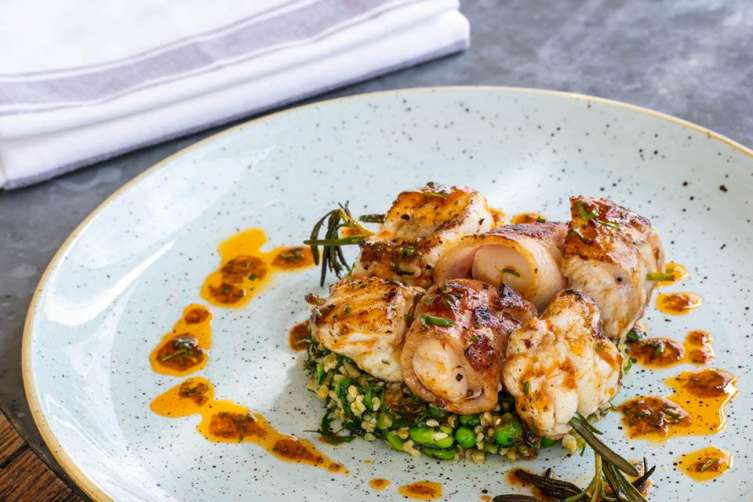 Charred monkfish, scallops and bacon, freekeh and habanero dressing