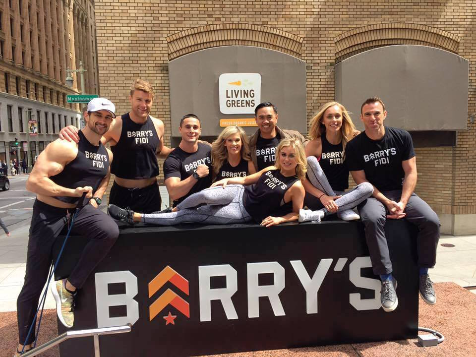 Trainers at Barry's Bootcamp pose beside the new Bush Street sign