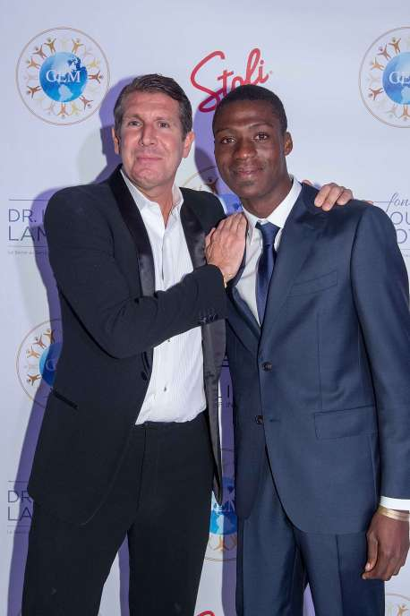 Micheal Capponi and Kesney Philippe attend 2nd Annual Global Empowerment Mission Gala at 1 Hotel South Beach