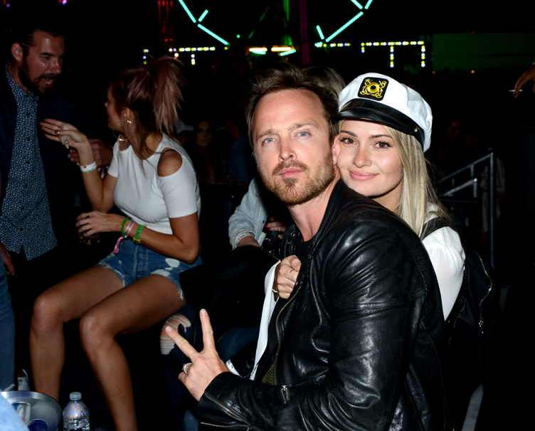 Aaron Paul (L) and Lauren Parsekian attend NEON CARNIVAL
