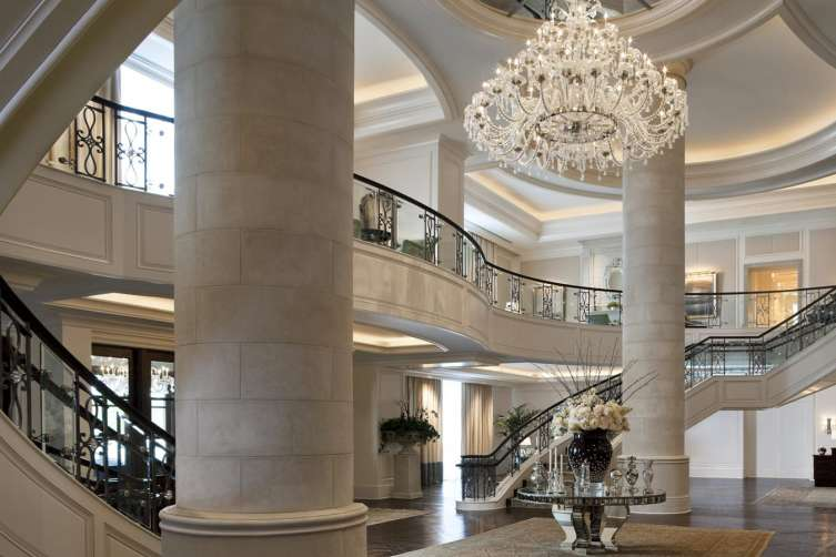 The Double Sweeping Staircases Vast Crystal Chandelier And Gorgeous Dark Wood Floors Are All Part Of Luxury Experience This Hotel Offers
