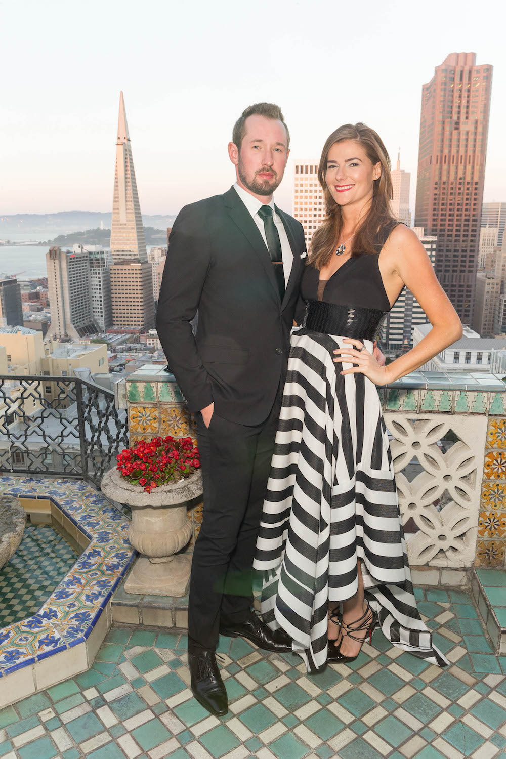 Iann Warmouth and Monika Sola attend UCSF Soirée at the Penthouse Suite at the Fairmont Hotel