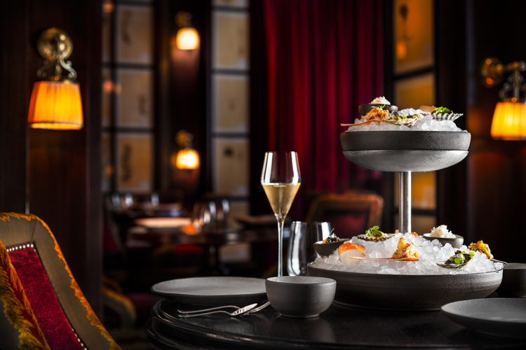 A tabletop presentation of Fruits de Mer with champagne in the NoMad Restaurant, NYC.