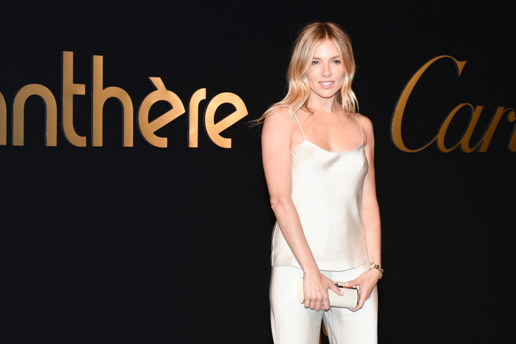 Sienna Miller attends the Panthere de Cartier party