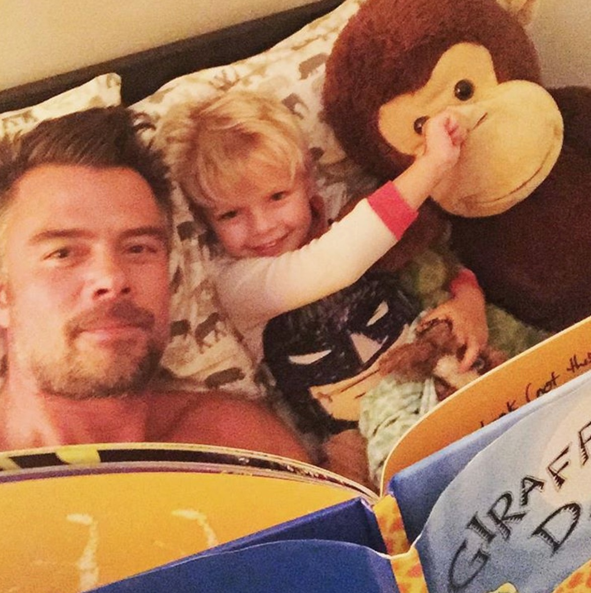 A recent image from Duhamel's Instagram account shows him reading to his son, Axl