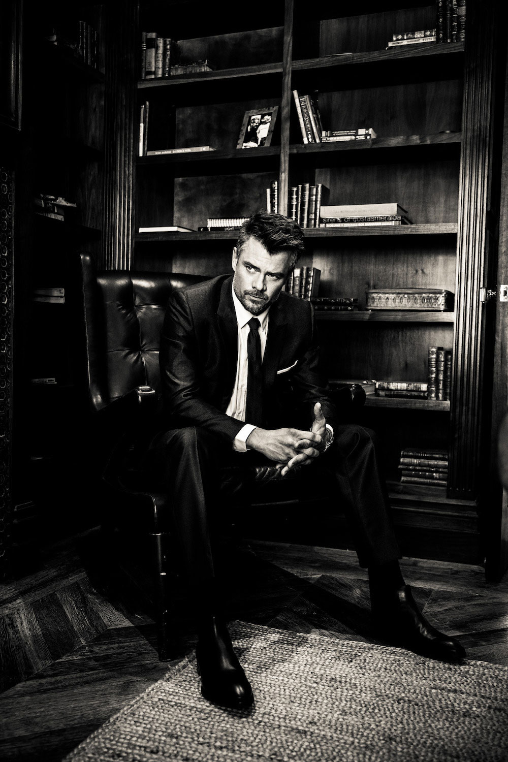 Josh poses in a Dior charcoal suit, Dolce & Gabbana shirt, Zegna tie and Panerai watch.