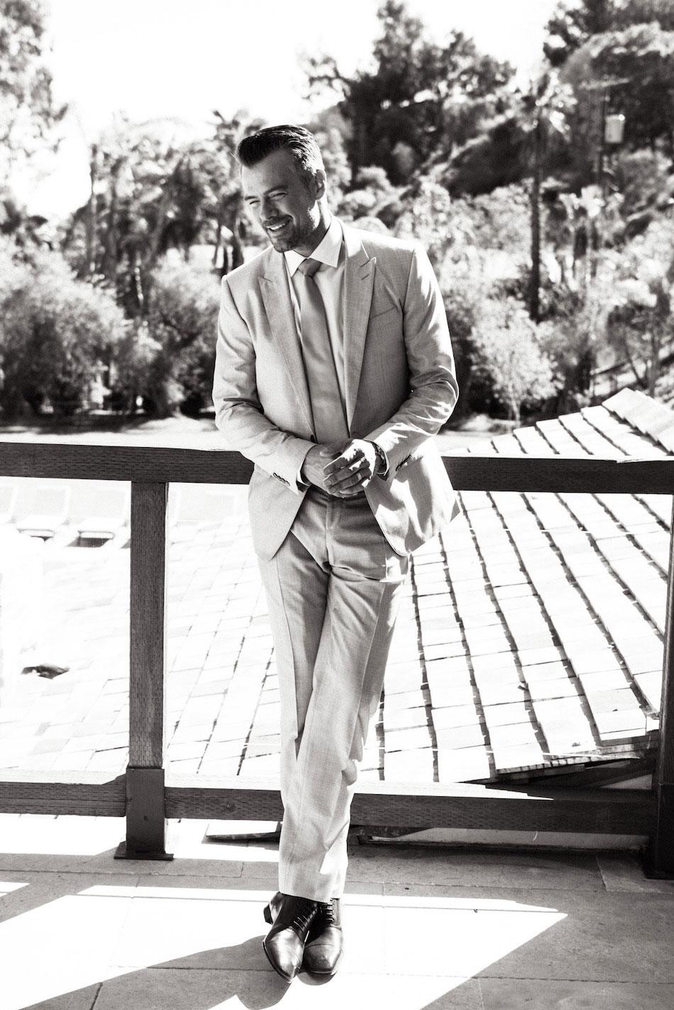 Duhamel looks dapper in a Dolce & Gabbana suit and tie, a John Varvatos button-up shirt, Louboutin dress shoes and a Panerai watch.