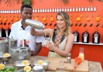 Ali Larter pours a drink at the Cointreau summertime soiree