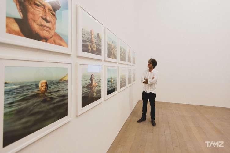 "Cuban photographer Juan Carlos Alom alongside his work ""Nacidos Para Ser Libres"""