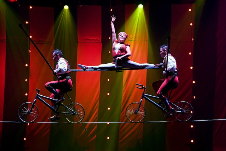 The members of Los Lopez perform a high-wire act.