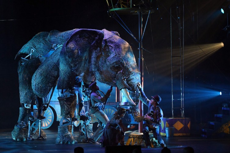 """Puppeteers and cast members perform with an elephant puppet named Queenie during the opening night of """"Circus 1903"""" at Paris Las Vegas."""
