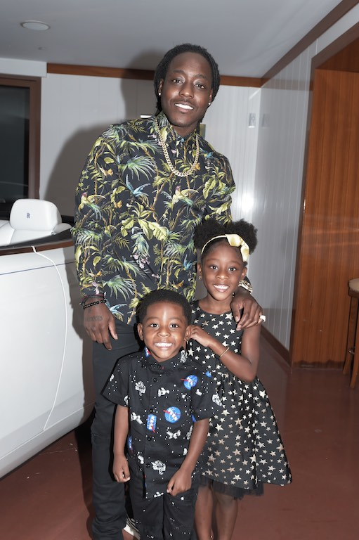 Ace Hood with children