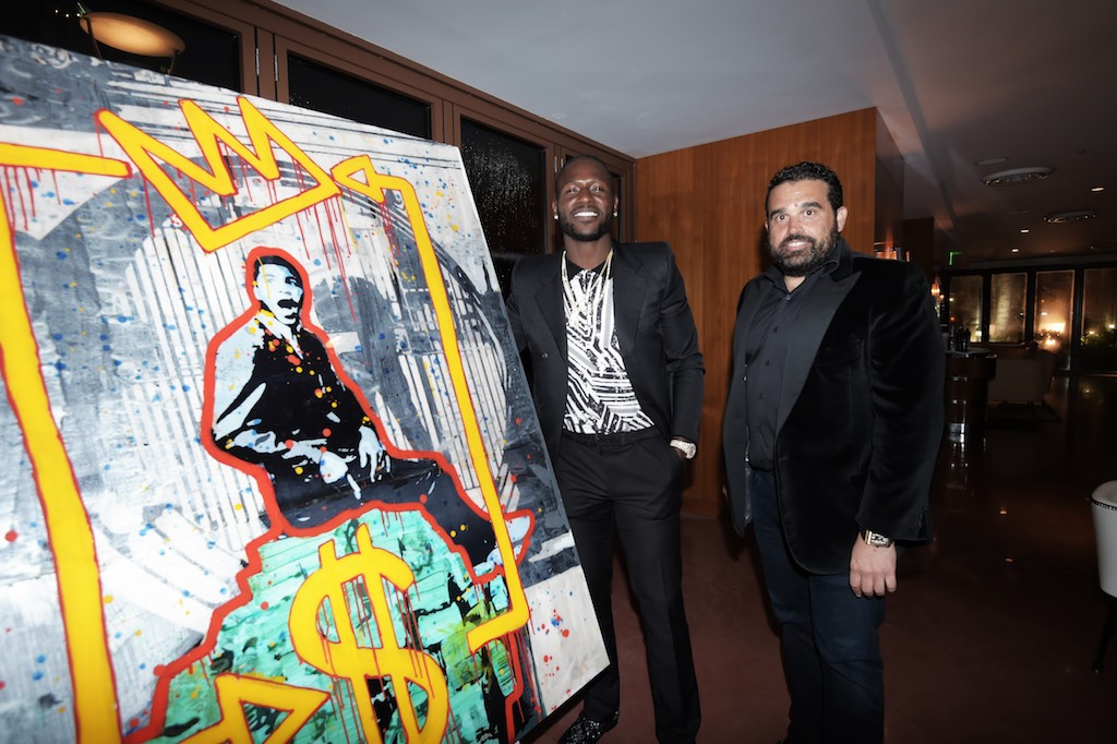 Antonio Brown and Seth Semilof with painting from Shawn Kolodny