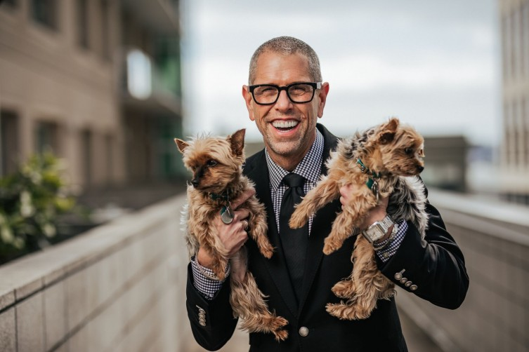 Andrew Freeman poses with his dogs