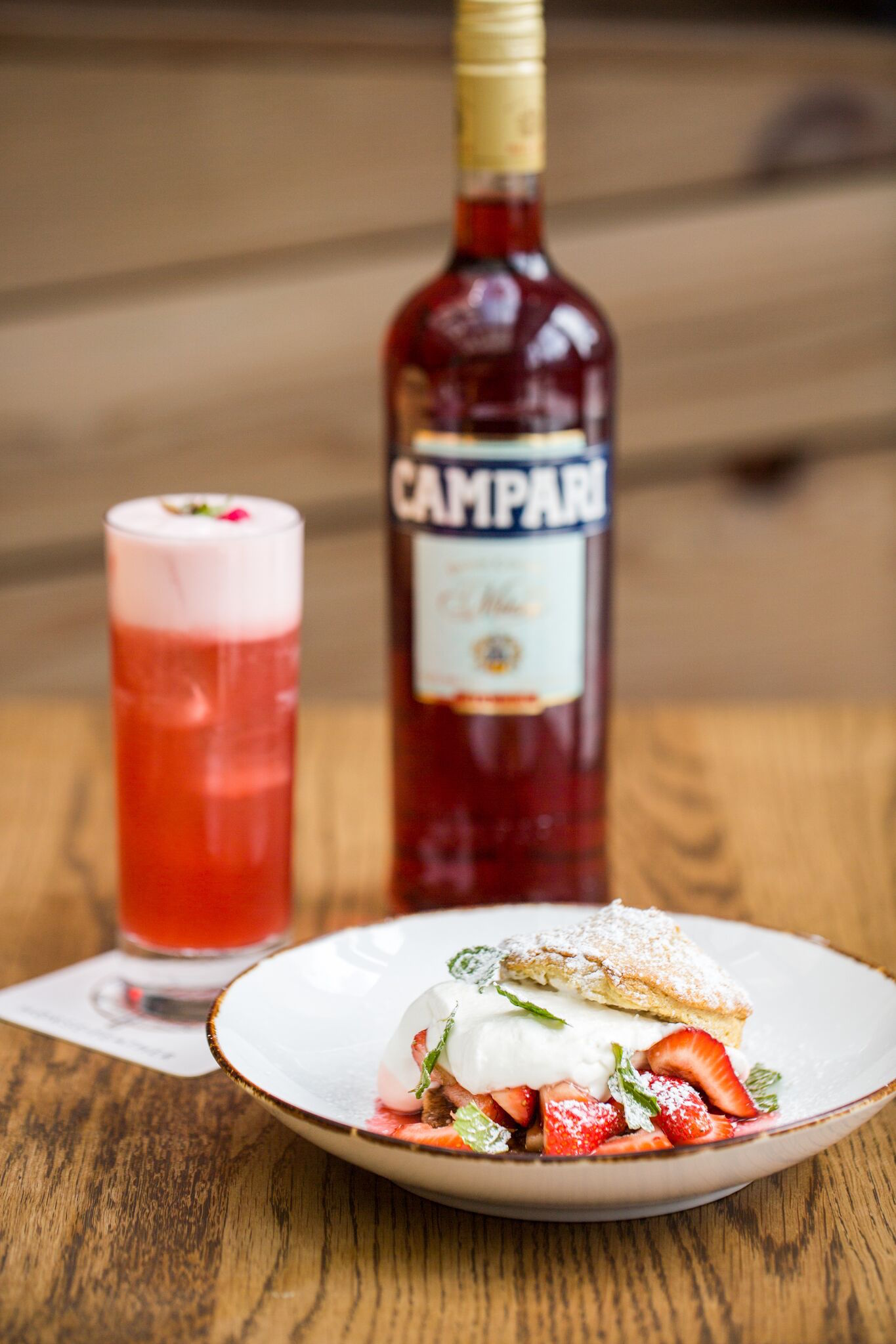 Chef Chinchilla's strawberry shortcake with Campari syrup alongside the Campari libation