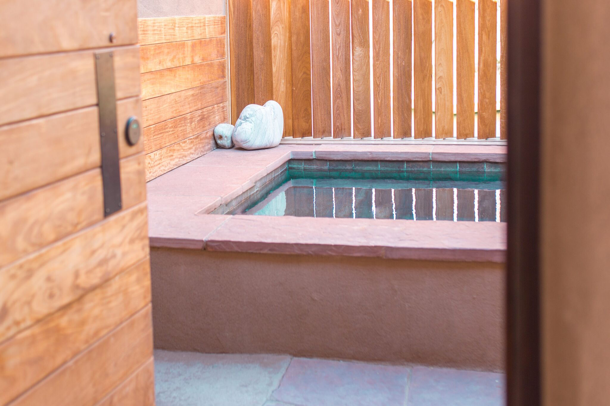 A private outdoor soaking tub at the spa