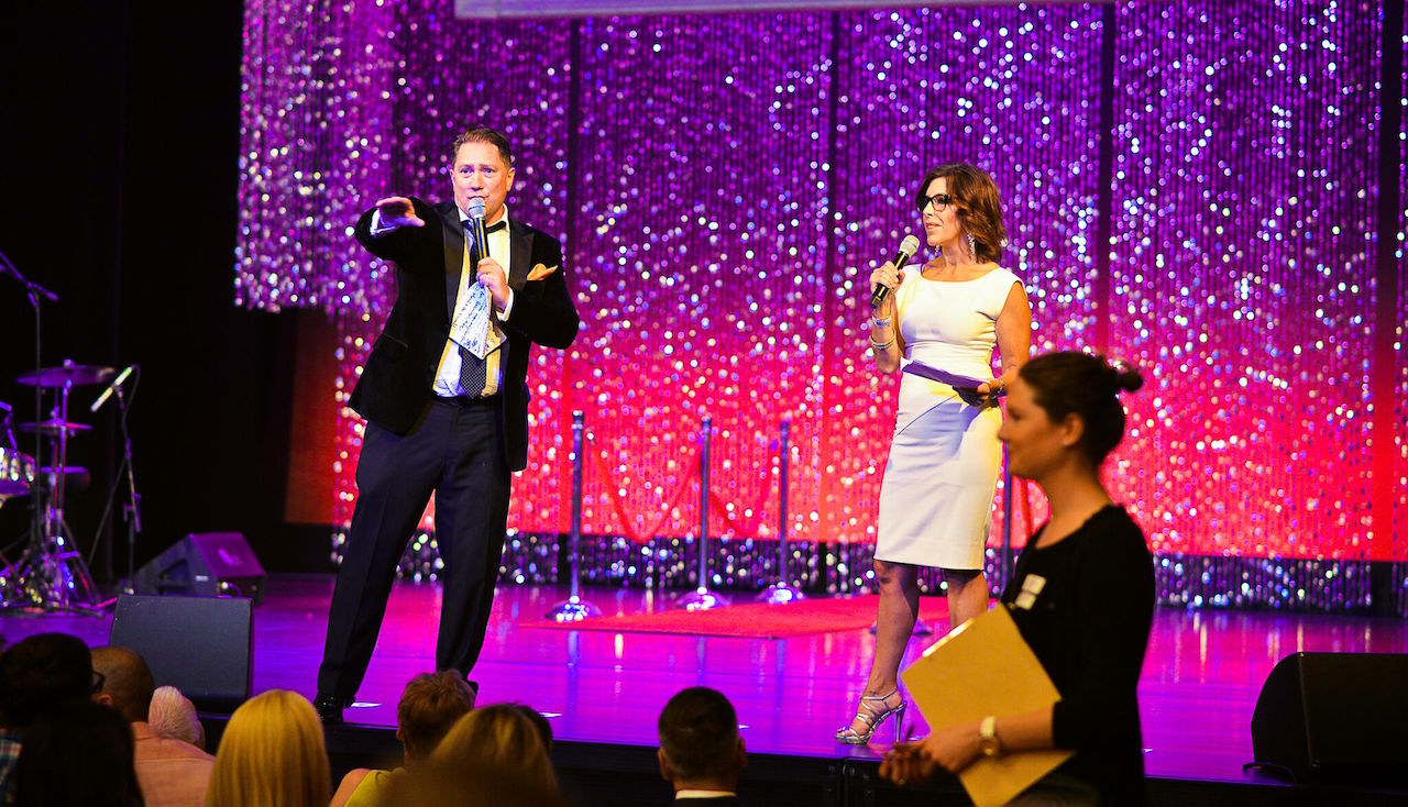 Liam Mayclem and Jessica Aguirre lead the live auction