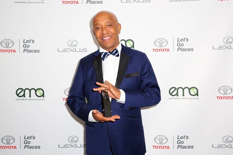 Russell Simmons poses backstage with the EMA Missions in Music Award