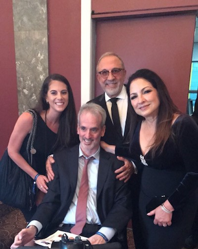 Ashley Fern of Haute Living, her father and former Miami Project Patient Keith Fern, and Gloria & Emilio Estefan