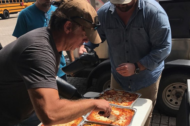 John Besh serving food on behalf of his John Besh Foundation
