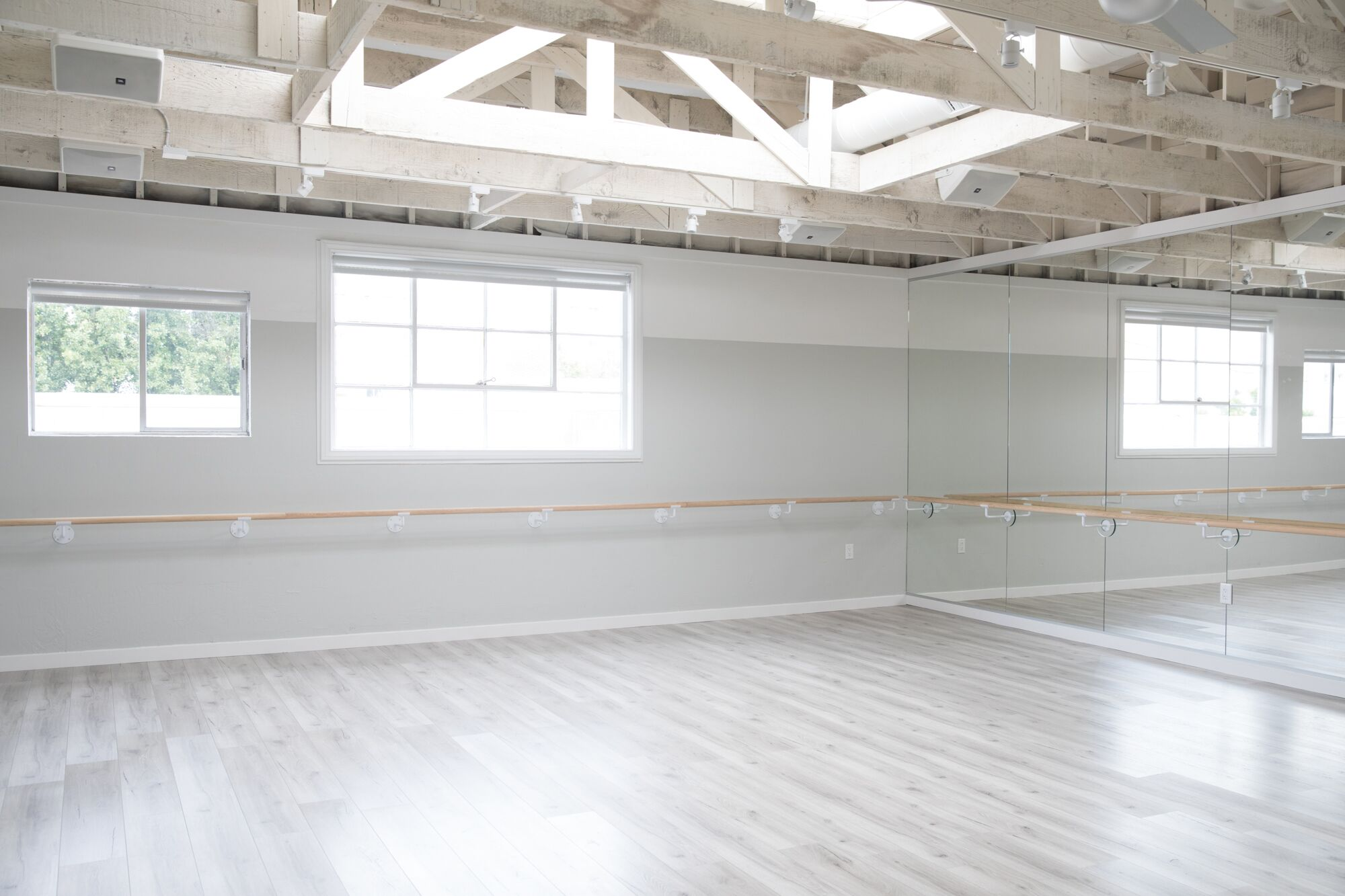 Natural light floods the barre classroom