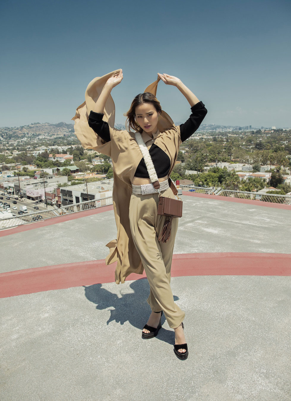 Chung isn't slowing down. Here she walks the roof at the Sofitel as if it were a catwalk in a Michael Kors blouse and pants, Milly top, Max Mara belt, Lady Bird earrings, Alchima di Ballin shoes, and Zues and Dione purse.