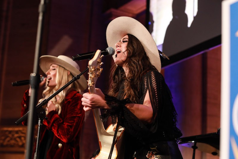 Country-rock duo The Sisterhood (Ruby Stewart and Alyssa Bonagura) perform at The Skin Cancer Foundation Champions for Change Gala.